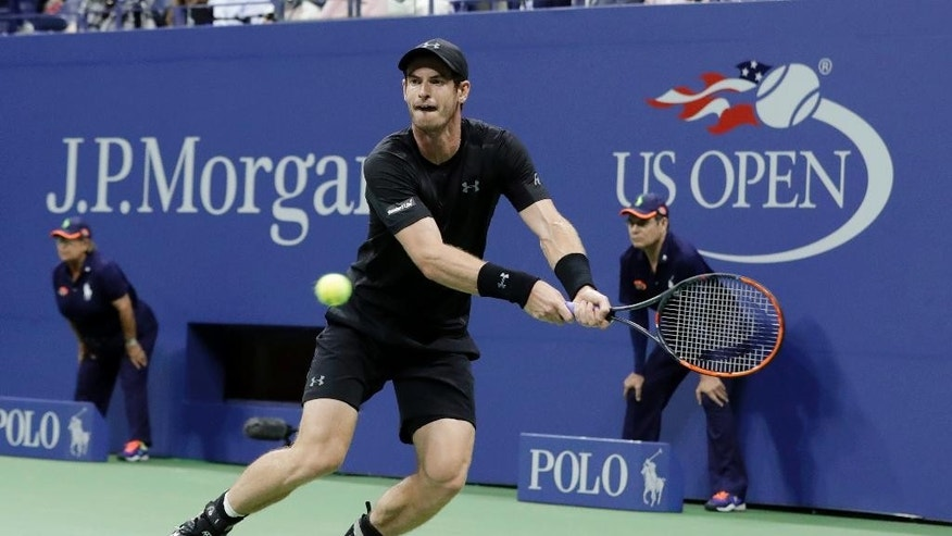 Andy Murray, of Britain, returns a shot to Lukas Rosol, of the Czech Republic, during the first round of the U.S. Open tennis tournament, Tuesday, Aug. 30, 2016, in New York. (AP Photo/Darron Cummings)
