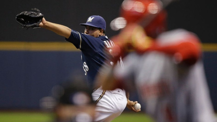 Milwaukee Brewers starting pitcher Wily Peralta throws to the Cincinnati Reds' Billy Hamilton during the first inning Monday, April 20, 2015, in Milwaukee.