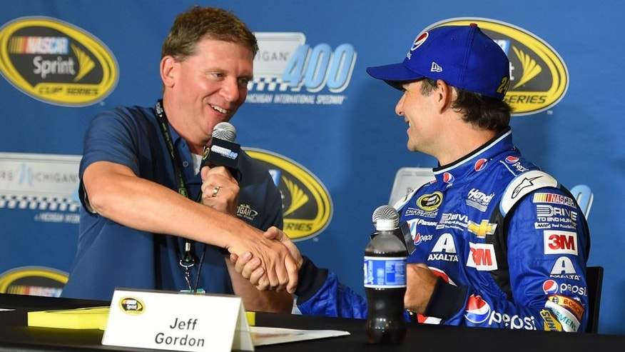 BROOKLYN, MI - AUGUST 14: (L-R)Michigan International Speedway president Roger Curtis speaks to Jeff Gordon, driver of the #24 Pepsi Chevrolet, during a press conference before practice for the NASCAR Sprint Cup Series Pure Michigan 400 at Michigan International Speedway on August 14, 2015 in Brooklyn, Michigan. (Photo by Josh Hedges/Getty Images)