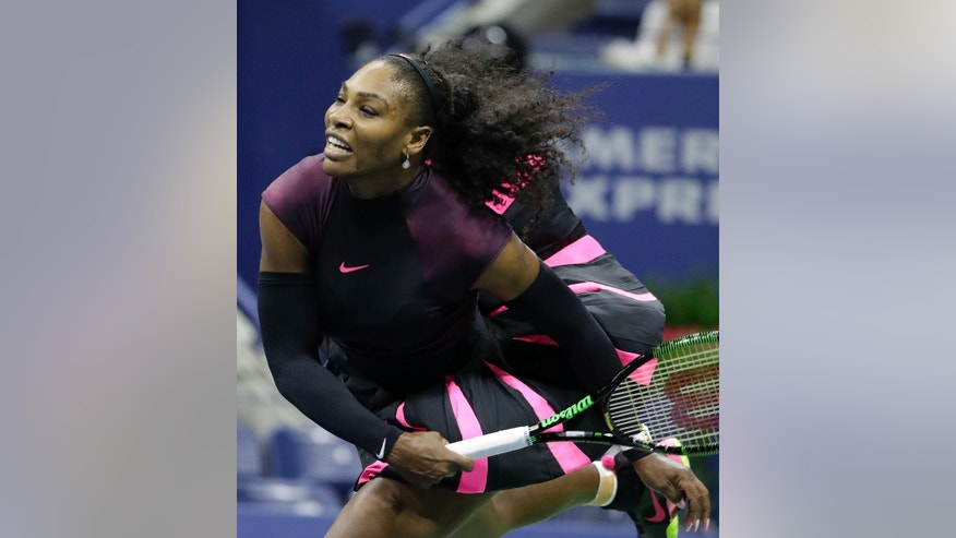 Serena Williams serves to Ekaterina Makarova, of Russia, during the first round of the U.S. Open tennis tournament, Tuesday, Aug. 30, 2016, in New York. (AP Photo/Darron Cummings)