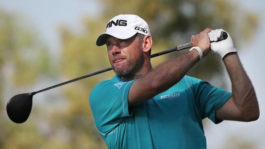 FILE - In this Nov. 19, 2015, file photo, Lee Westwood of England tees off on the second hole during the round one of DP World Tour Championship golf tournament in Dubai, United Arab Emirates. Lee Westwood, Martin Kaymer and Thomas Pieters will fill out the European team as Darren Clarke's captain's picks for the Ryder Cup at Hazeltine from Sept. 30-Oct. 2. Clarke announced his choices at the European Tour headquarters at Wentworth on Tuesday, Aug. 30, 2016. (AP Photo/Kamran Jebreili, File)