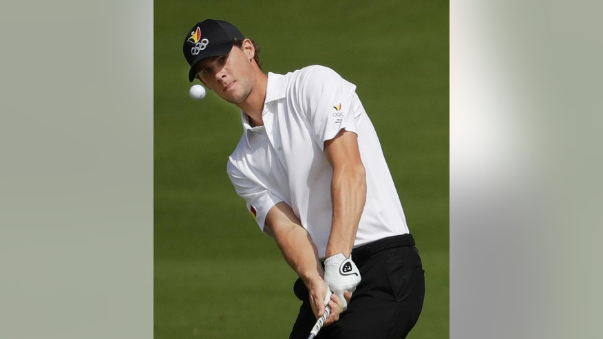 FILE - In this Thursday, Aug. 11, 2016 file photo, Thomas Pieters of Belgium hits the ball on the 16th green during the first round of the men's golf event at the 2016 Summer Olympics in Rio de Janeiro, Brazil.  Lee Westwood, Martin Kaymer and Thomas Pieters will fill out the European team as Darren Clarke's captain's picks for the Ryder Cup at Hazeltine from Sept. 30-Oct. 2. Clarke announced his choices at the European Tour headquarters at Wentworth on Tuesday, Aug. 30, 2016. (AP Photo/Chris Carlson, File)