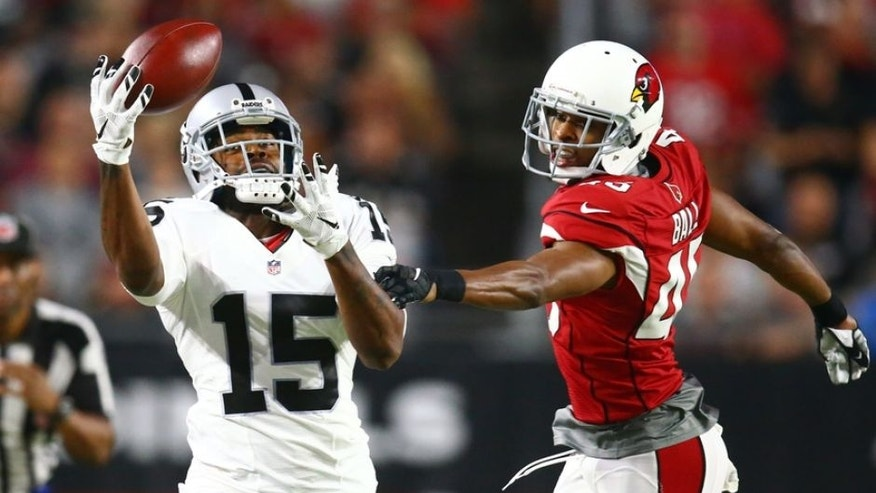 Aug 12, 2016; Glendale, AZ, USA; Oakland Raiders wide receiver Michael Crabtree (15) makes a one handed catch against Arizona Cardinals cornerback Alan Ball in the first quarter during a preseason game at University of Phoenix Stadium. Mandatory Credit: Mark J. Rebilas-USA TODAY Sports