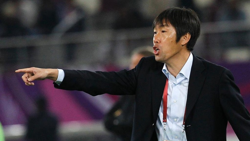 FILE - In this Jan. 21, 2011, file photo, China's team coach Gao Hongbo reacts during their AFC Asian Cup group A soccer match against Qatar in Doha, Qatar. The third round of the Asian region World Cup qualifiers begins Thursday, May 1, 2016, with 12 teams still in the running for a place at the 2018 FIFA World Cup in Russia. (AP Photo/Hassan Ammar, File)