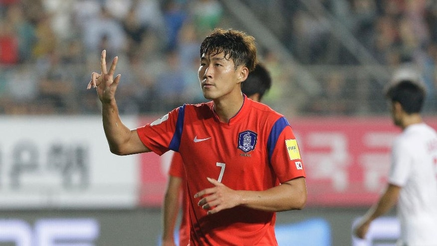 FILE - In this Sept. 3, 2015, file photo, South Korea's Son Heung-min celebrates scoring a hat-trick against Laos during the Asian zone Group G qualifying soccer match for the 2018 World Cup at Hwaseong Sports Complex Main Stadium in Hwaseong, South Korea. The third round of the Asian region World  Cup qualifiers begins Thursday, May 1, 2016, with 12 teams still in the running for a place at the 2018 FIFA World Cup in Russia. (AP Photo/Ahn Young-joon, File)