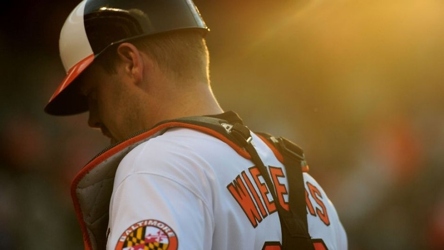 Aug 29, 2016; Baltimore, MD, USA; Baltimore Orioles catcher Matt Wieters (32) walks to the dugout before a game against the Toronto Blue Jays at Oriole Park at Camden Yards. Mandatory Credit: Evan Habeeb-USA TODAY Sports