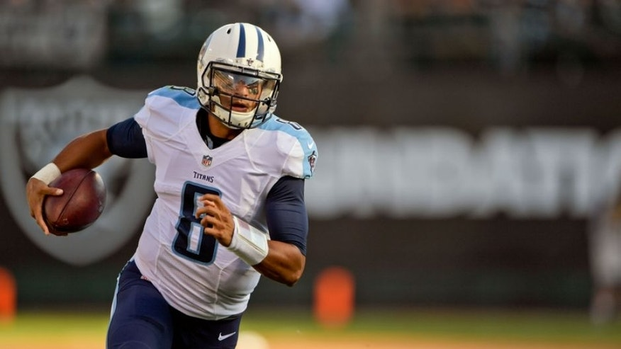 Aug 27, 2016; Oakland, CA, USA; Tennessee Titans quarterback Marcus Mariota (8) rushes against the Oakland Raiders during the first half at Oakland-Alameda Coliseum. Mandatory Credit: Kirby Lee-USA TODAY Sports