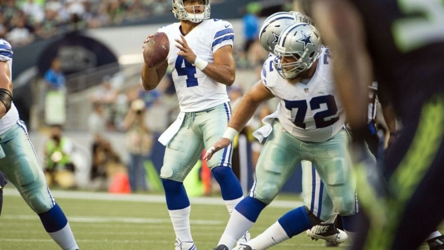 Aug 25, 2016; Seattle, WA, USA; Dallas Cowboys quarterback Dak Prescott (4) looks for a receiver during the first quarter in a preseason game against the Seattle Seahawks at CenturyLink Field. Mandatory Credit: Troy Wayrynen-USA TODAY Sports