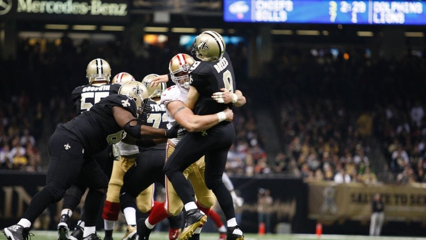 NEW ORLEANS, LA - NOVEMBER 9: Justin Smith #94 of the San Francisco 49ers pressures Drew Brees #9 of the New Orleans Saints during the game at the Mercedes-Benz Superdome on November 9, 2014 in New Orleans, Louisiana. The 49ers defeated the Saints 27-24. (Photo by Michael Zagaris/San Francisco 49ers/Getty Images)