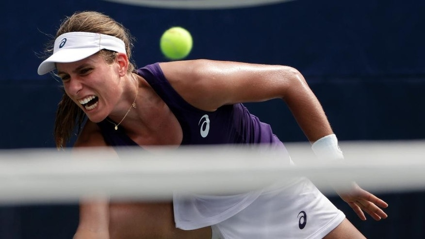 Johanna Konta, of the United Kingdom, returns a shot to Tsvetana Pironkova, of Bulgaria, during the second round of the U.S. Open tennis tournament, Wednesday, Aug. 31, 2016, in New York. (AP Photo/Frank Franklin II)