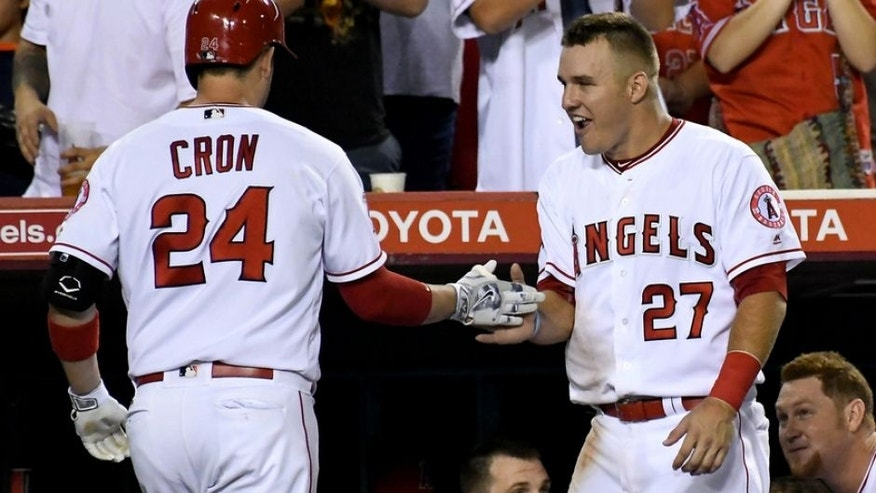 Aug 30, 2016; Anaheim, CA, USA; Los Angeles Angels first baseman C.J. Cron (24) is met by Los Angeles Angels center fielder Mike Trout (27) after his second home run of the game in the third inning against the Cincinnati Reds at Angel Stadium of Anaheim. Mandatory Credit: Jayne Kamin-Oncea-USA TODAY Sports