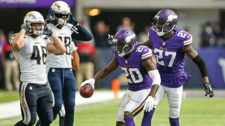 Aug 28, 2016; Minneapolis, MN, USA; Minnesota Vikings cornerback Mackensie Alexander (20) goes by the San Diego Chargers bench to celebrate after intercepting a pass as Vikings safety Jayron Kearse (27) looks on in the fourth quarter at U.S. Bank Stadium. Alexander was penalized for unsportsmanlike conduct. The Vikings won 23-10. Mandatory Credit: Bruce Kluckhohn-USA TODAY Sports