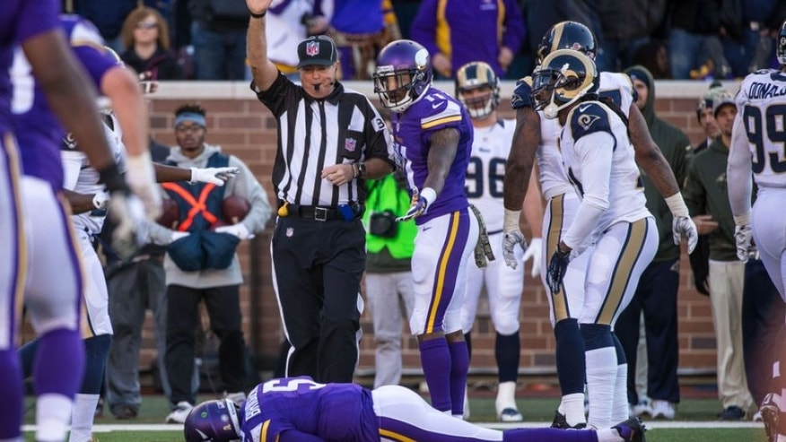 Nov 8, 2015; Minneapolis, MN, USA; Minnesota Vikings quarterback Teddy Bridgewater (5) injured after a late hit during the fourth quarter against the St. Louis Rams at TCF Bank Stadium. The Vikings defeated the Rams 21-18. Mandatory Credit: Brace Hemmelgarn-USA TODAY Sports