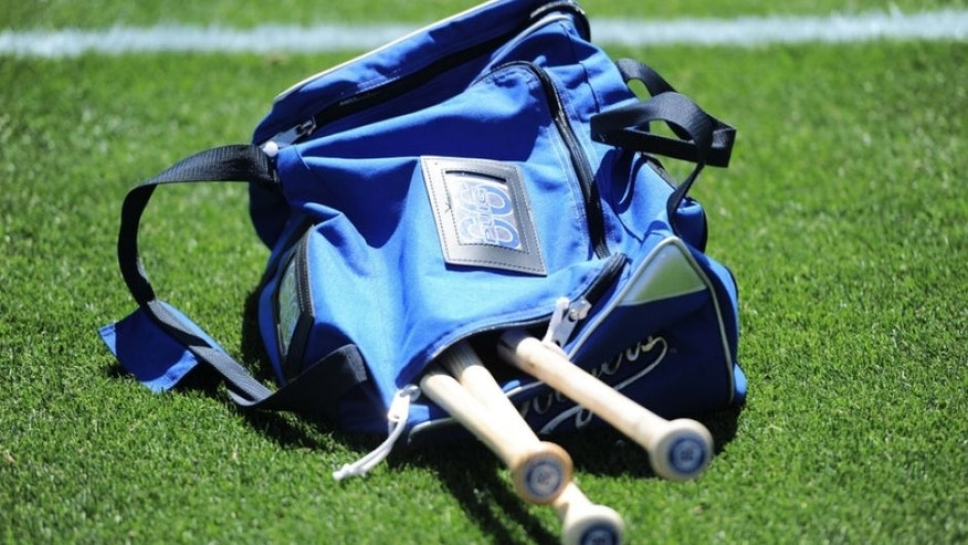 Mar 25, 2015; Phoenix, AZ, USA; The bat bag of Los Angeles Dodgers right fielder Yasiel Puig (not pictured) sits on the field before the game against the San Diego Padres at Camelback Ranch. Mandatory Credit: Joe Camporeale-USA TODAY Sports