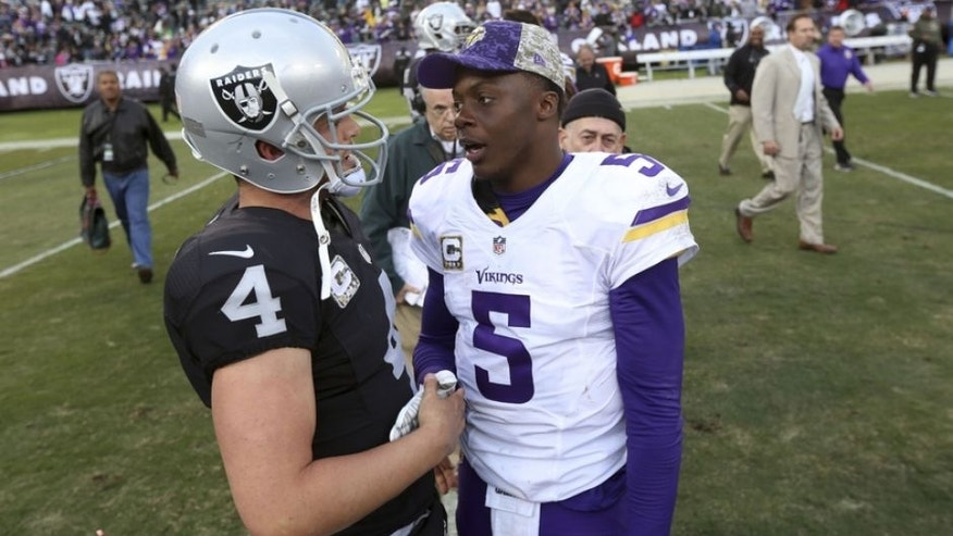 Nov 15, 2015; Oakland, CA, USA; Oakland Raiders quarterback Derek Carr (4) talks with Minnesota Vikings quarterback Teddy Bridgewater (5) after the game at O.co Coliseum. The Vikings defeated the Raiders 30-14. Mandatory Credit: Cary Edmondson-USA TODAY Sports