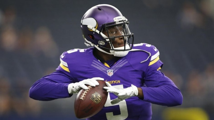 Aug 29, 2015; Arlington, TX, USA; Minnesota Vikings quarterback Teddy Bridgewater (5) throws a pass in the warm ups before the game against the Dallas Cowboys at AT&T Stadium. Mandatory Credit: Tim Heitman-USA TODAY Sports