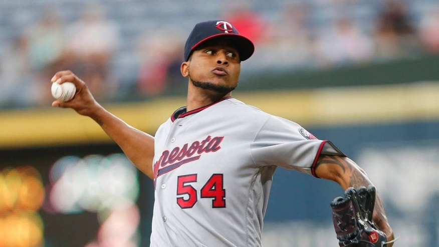 Minnesota Twins starter Ervin Santana delivers a pitch during the first inning of a baseball game against the Atlanta Braves in Atlanta, Tuesday, Aug. 16, 2016, (AP Photo/John Bazemore)