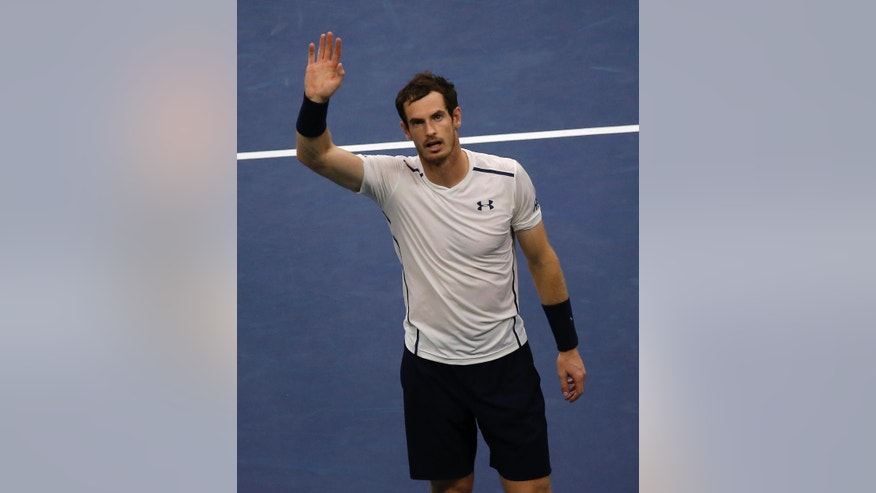 Andy Murray, of the United Kingdom, waves to fans after defeating Marcel Granollers, of Spain, during the second round of the U.S. Open tennis tournament, Thursday, Sept. 1, 2016, in New York. (AP Photo/Andres Kudacki)