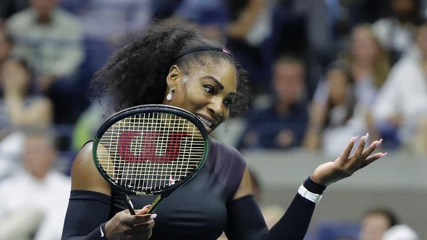 Serena Williams reacts after missing a shot against Vania King during the second round of the U.S. Open tennis tournament, Thursday, Sept. 1, 2016, in New York. (AP Photo/Darron Cummings)