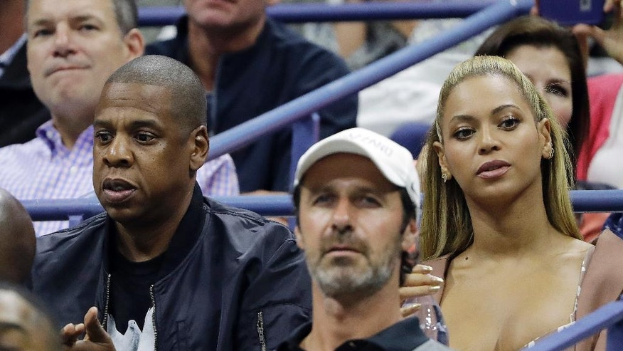 Beyonce and Jay Z watch the match between Serena Williams and Vania King during the second round of the U.S. Open tennis tournament, Thursday, Sept. 1, 2016, in New York. (AP Photo/Darron Cummings)