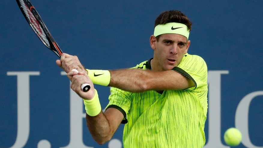 Juan Martin del Potro, of Argentina, returns a shot to Diego Schwartzman, of Argentina, during the first round of the U.S. Open tennis tournament, Tuesday, Aug. 30, 2016, in New York. (AP Photo/Alex Brandon)