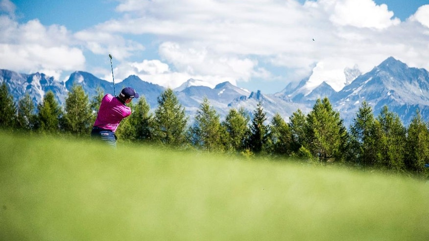 Ireland's Paul Dunne is in action during the first round of the Omega European Masters Golf tournament in Crans-Montana, Switzerland, Thursday, Sept. 1, 2016. (Olivier Maire/Keystone via AP)