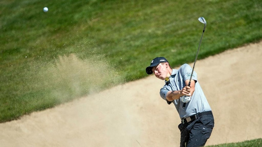 England's Matthew Fitzpatrick is in action during the first round of the Omega European Masters Golf tournament in Crans-Montana, Switzerland, Thursday, Sept. 1, 2016. (Olivier Maire/Keystone via AP)