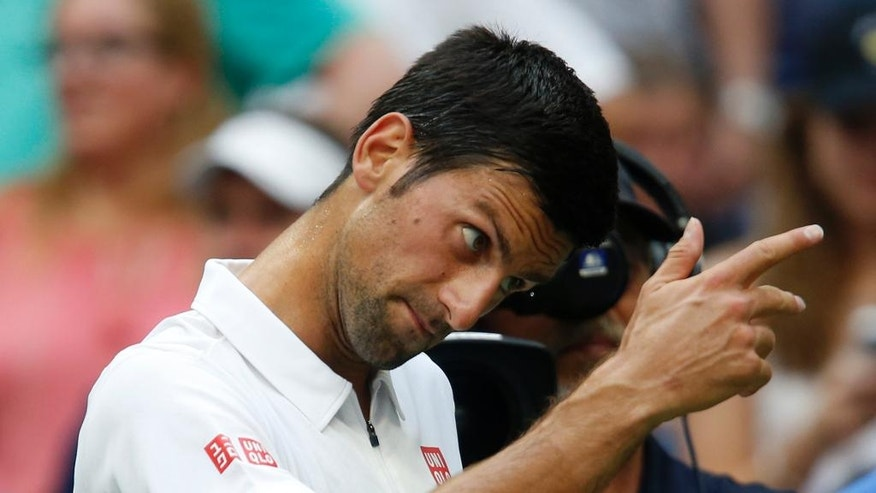 Novak Djokovic, of Serbia, motions after Mikhail Youzhny, of Russia, retired from their match in the first set during the third round of the U.S. Open tennis tournament, Friday, Sept. 2, 2016, in New York. (AP Photo/Jason DeCrow)