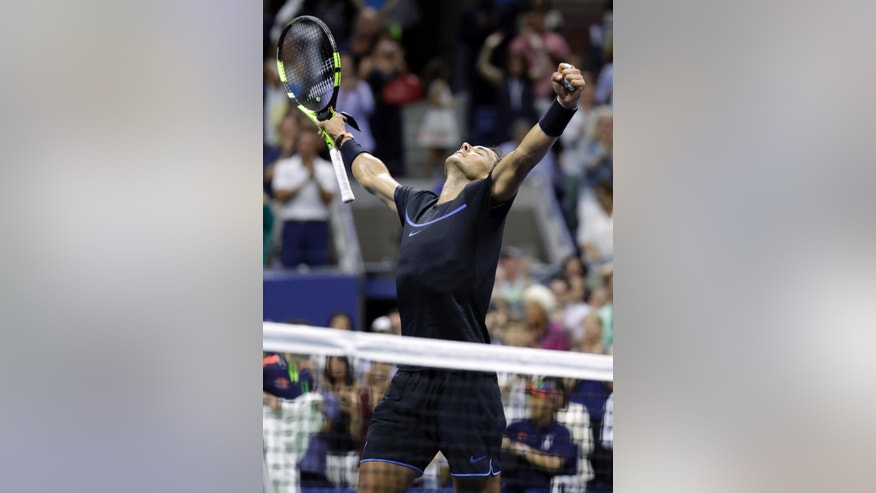 Rafael Nadal, of Spain, celebrates after defeating Andrey Kuznetsov, of Russia, at the U.S. Open tennis tournament, Friday, Sept. 2, 2016, in New York. (AP Photo/Julio Cortez)