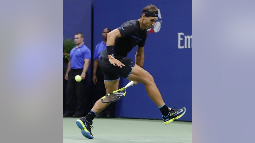 Rafael Nadal, of Spain, returns a shot between his legs to Andrey Kuznetsov, of Russia, during the U.S. Open tennis tournament, Friday, Sept. 2, 2016, in New York. (AP Photo/Julio Cortez)