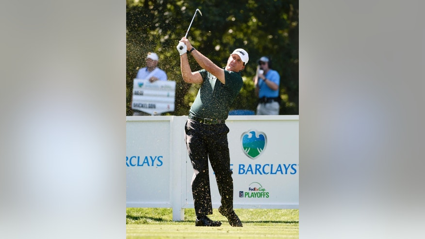 Phil Mickelson tees off on the eighth during the third round of the Barclays golf tournament in Farmingdale, N.Y., Saturday, Aug. 27, 2016. (AP Photo/Kathy Kmonicek)