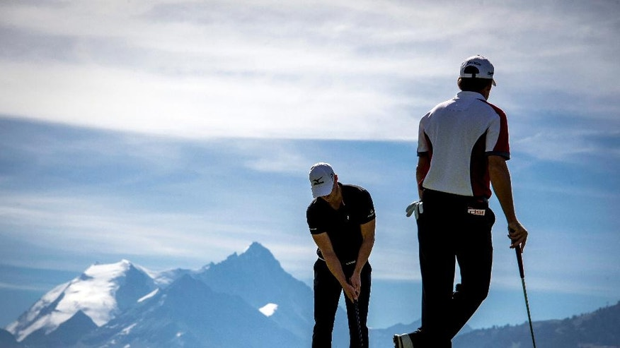 Players compete during the second round of the Omega European Masters Golf Tournament in Crans-Montana, Switzerland, Friday, Sept. 2, 2016.  (Olivier Maire/Keystone via AP)