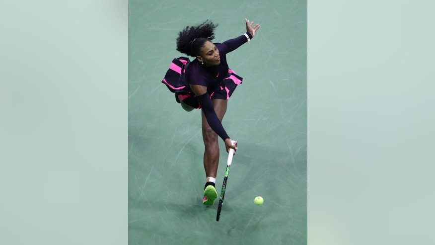Serena Williams returns a shot to Vania King, of the United States, during the second round of the U.S. Open tennis tournament, Thursday, Sept. 1, 2016, in New York. (AP Photo/Julio Cortez)