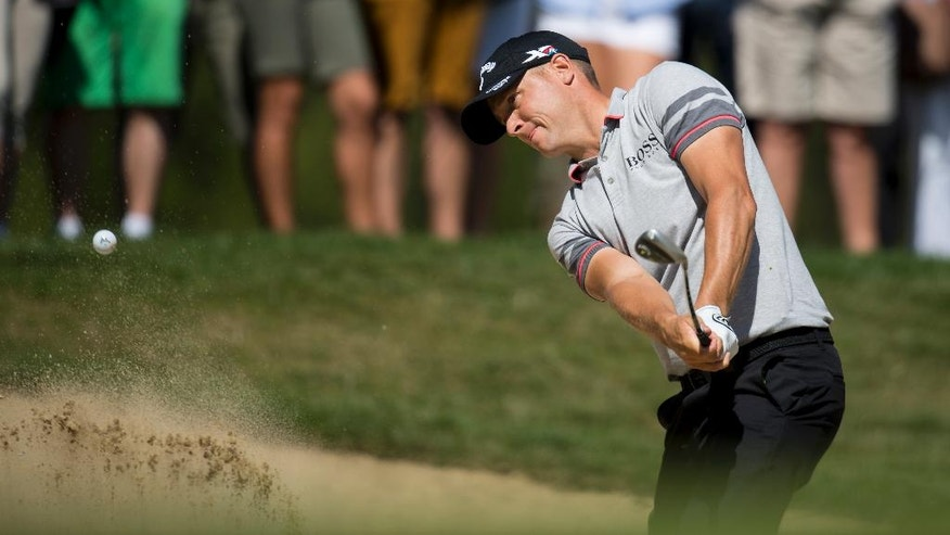 Alex Noren of Sweden hits out of a bunker  during the third round of the Omega European Masters Golf Tournament in Crans-Montana, Switzerland, Saturday, Sept. 3, 2016. (Jean-Christophe Bott/Keystone via AP)