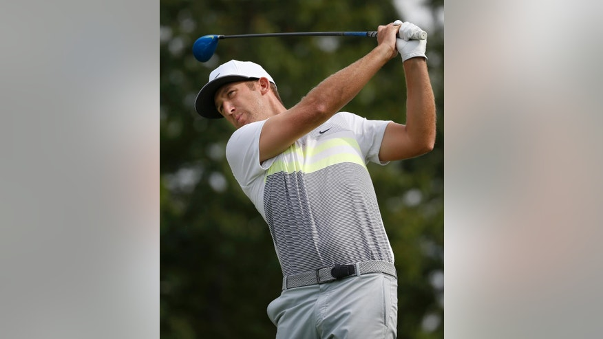 Kevin Chappell hits his tee shot on the 10th hole during the second round of the Deutsche Bank Championship golf tournament, Saturday, Sept. 3, 2016, in Norton, Mass. (AP Photo/Michael Dwyer)