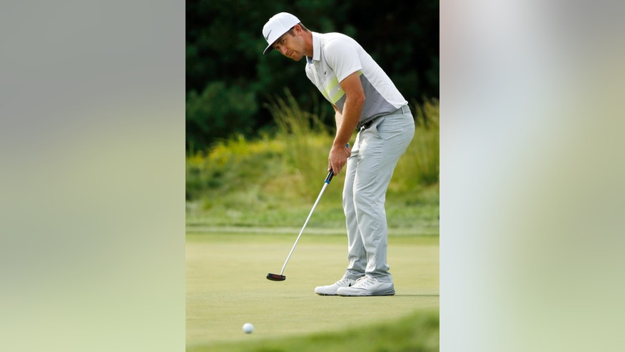 Kevin Chappell putts on the 10th green during the second round of the Deutsche Bank Championship golf tournament, Saturday, Sept. 3, 2016, in Norton, Mass. (AP Photo/Michael Dwyer)