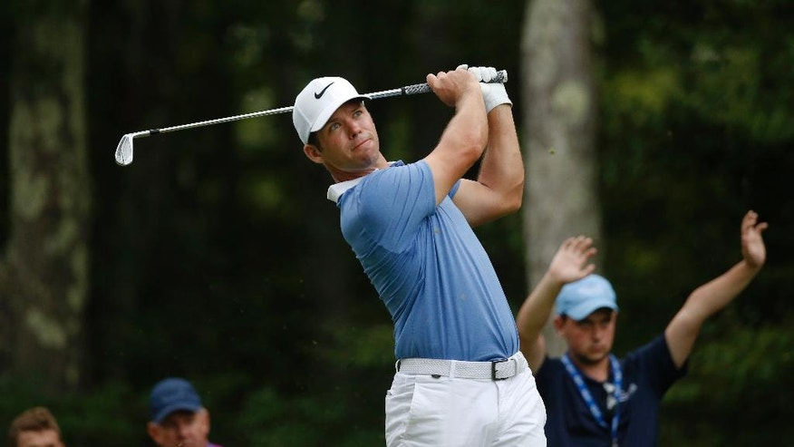 Paul Casey, of England, watches his tee shot on the eighth hole during the second round of the Deutsche Bank Championship golf tournament, Saturday, Sept. 3, 2016, in Norton, Mass. (AP Photo/Michael Dwyer)