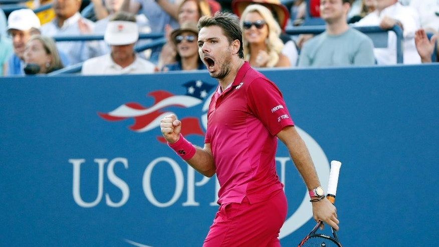 Stan Wawrinka, of Switzerland, reacts after winning the second set against Daniel Evans, of Britain, during the third round of the U.S. Open tennis tournament, Saturday, Sept. 3, 2016, in New York. (AP Photo/Adam Hunger)