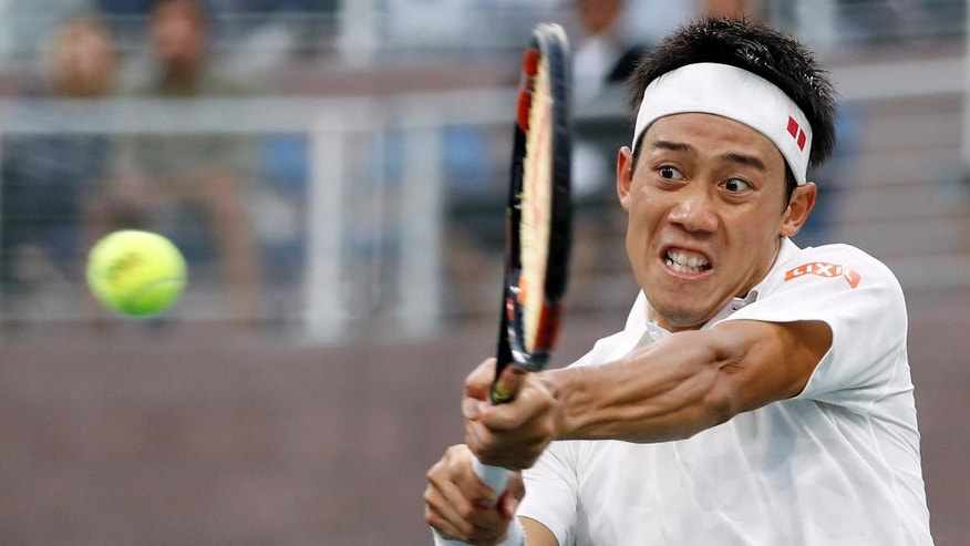 Kei Nishikori, of Japan, hits a return shot to Nicolas Mahut, of France, during the third round of the U.S. Open tennis tournament, Saturday, Sept. 3, 2016, in New York. (AP Photo/Adam Hunger)