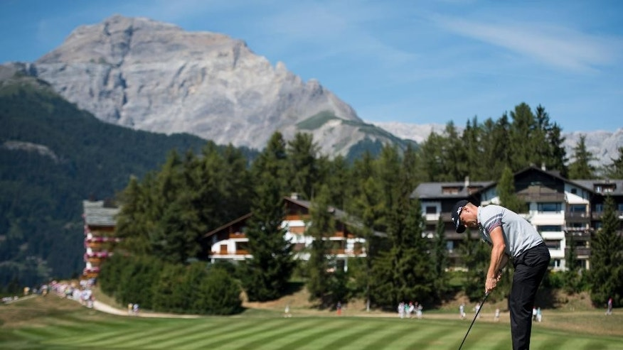 Alex Noren of Sweden plays the ball during the third round of the Omega European Masters Golf Tournament in Crans-Montana, Switzerland, Saturday, Sept. 3, 2016. (Jean-Christophe Bott/Keystone via AP)