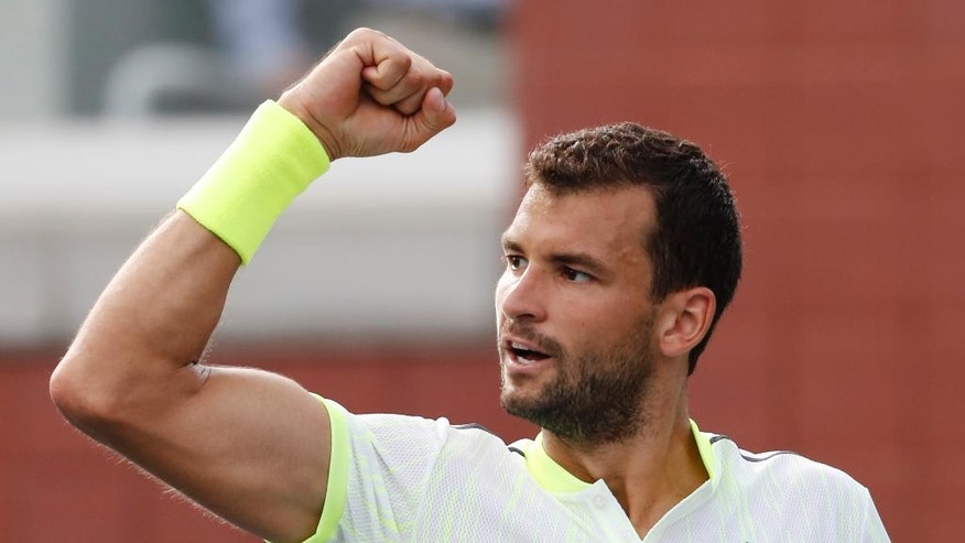 Grigor Dimitrov, of Bulgaria, reacts after a point against Joao Sousa, of Portugal, during the third round of the U.S. Open tennis tournament, Saturday, Sept. 3, 2016, in New York. (AP Photo/Alex Brandon)