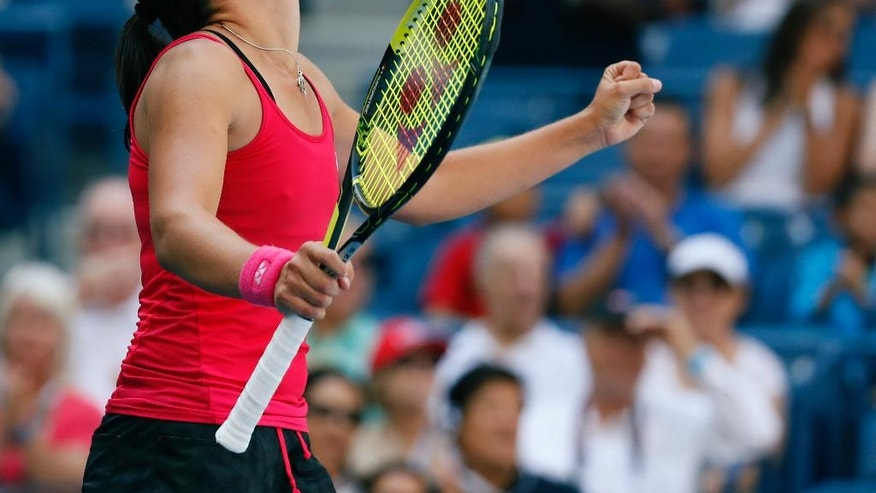 Anastasija Sevastova, of Latvia, celebrates after winning her match with Johanna Konta, of the United Kingdom, during the fourth round of the U.S. Open tennis tournament, Sunday, Sept. 4, 2016, in New York. (AP Photo/Alex Brandon)