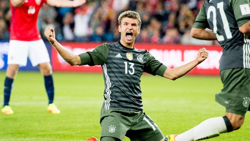 Germany's Thomas Muller celebrates after scoring his side's third goal of the game against Norway during their World Cup Group C qualifying soccer match in Oslo, Sunday, Sept. 4, 2016. (Jon Olav Nesvold/NTB Scanpix via AP)