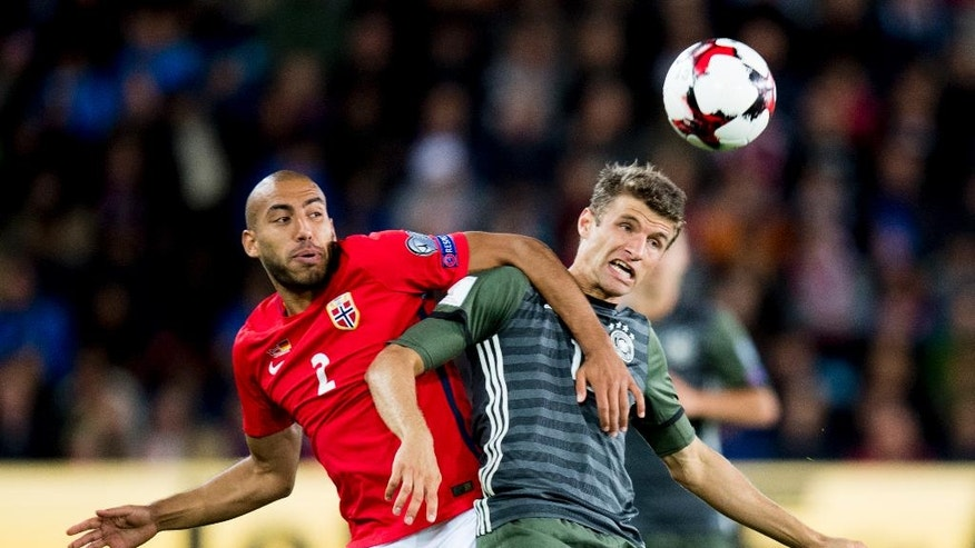 Norway's Haitam Aleesami, left, battles for the ball with Germany's Thomas Muller during their World Cup Group C qualifying soccer match in Oslo, Sunday, Sept. 4, 2016. (Jon Olav Nesvold/NTB Scanpix via AP)