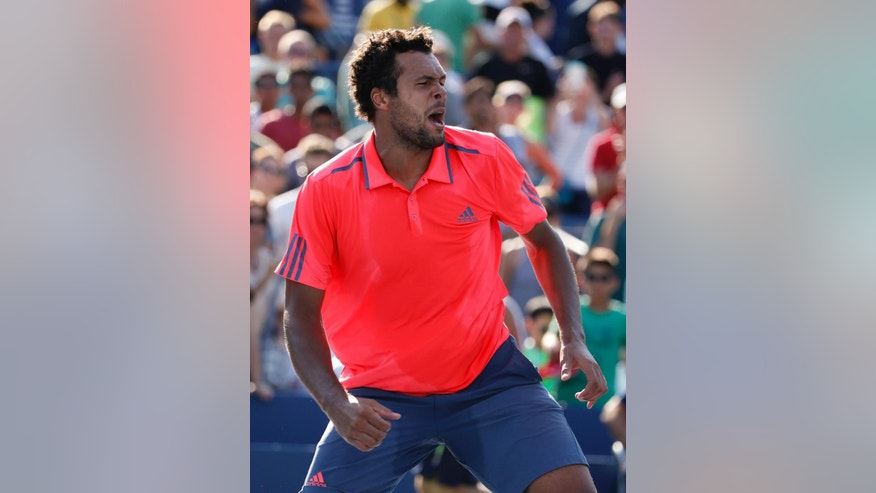 Jo-Wilfried Tsonga, of France, celebrates after beating Jack Sock, of the United States, during the fourth round of the U.S. Open tennis tournament, Sunday, Sept. 4, 2016, in New York. (AP Photo/Kathy Willens)