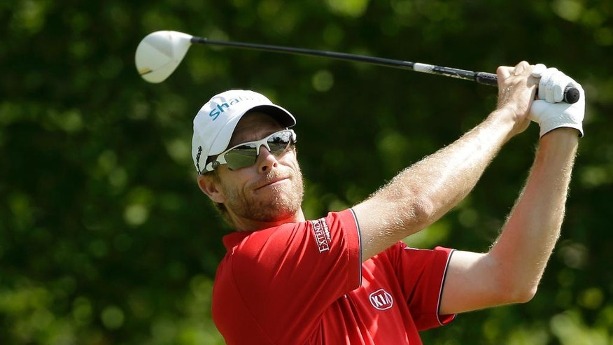 David Hearn, of Canada, watches his tee shot on the fourth hole during the third round of the Deutsche Bank Championship golf tournament Sunday, Sept. 4, 2016, in Norton, Mass. (AP Photo/Steven Senne)