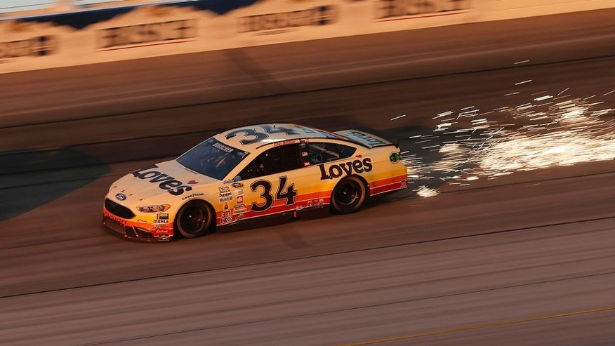 DARLINGTON, SC - SEPTEMBER 04: Clint Bowyer, driver of the #15 5-hour Energy Chevrolet, races Chris Buescher, driver of the #34 Love's Travel Stops Ford, during the NASCAR Sprint Cup Series Bojangles' Southern 500 at Darlington Raceway on September 4, 2016 in Darlington, South Carolina. (Photo by Brian Lawdermilk/Getty Images)