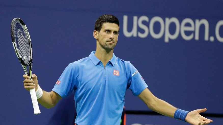 Novak Djokovic, of Serbia, reacts after missing a shot against Kyle Edmund, of Britain, during the fourth round of the U.S. Open tennis tournament, Sunday, Sept. 4, 2016, in New York. (AP Photo/Darron Cummings)
