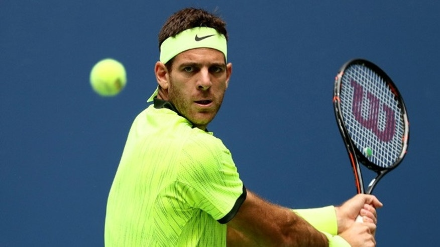 NEW YORK, NY - SEPTEMBER 05:  Juan Martin del Potro of Argentina returns a shot to against Dominic Thiem of Austria during his fourth round Men's Singles match on Day Eight of the 2016 US Open at the USTA Billie Jean King National Tennis Center on September 5, 2016 in the Flushing neighborhood of the Queens borough of New York City.  (Photo by Al Bello/Getty Images)