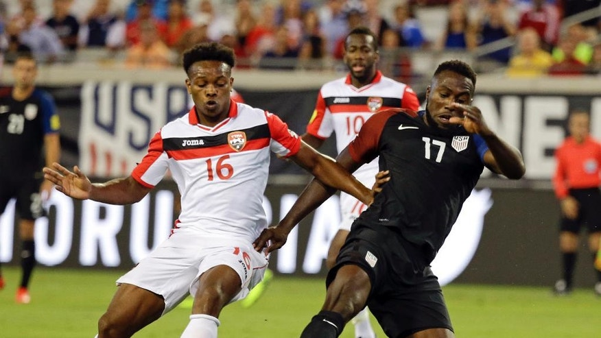 Trinidad & Tobago's Levi Garcia (16) and United States' Jozy Altidore (17) battle for possession of the ball during the first half of a CONCACAF World Cup qualifying soccer match, Tuesday, Sept. 6, 2016, in Jacksonville, Fla. (AP Photo/John Raoux)